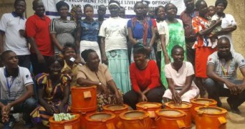 Beneficiaries of the Women Empowerment Project pose for a picture after receiving energy saving stoves from SAADO.