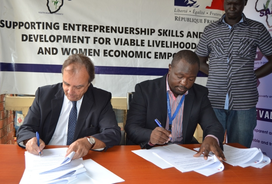 SAADO Programs Director, Stephen Omondi and His Excellency, Jean-Yves Roux, the French Ambassador signing the two contracts of cooperation. Photo Credit: SAADO.